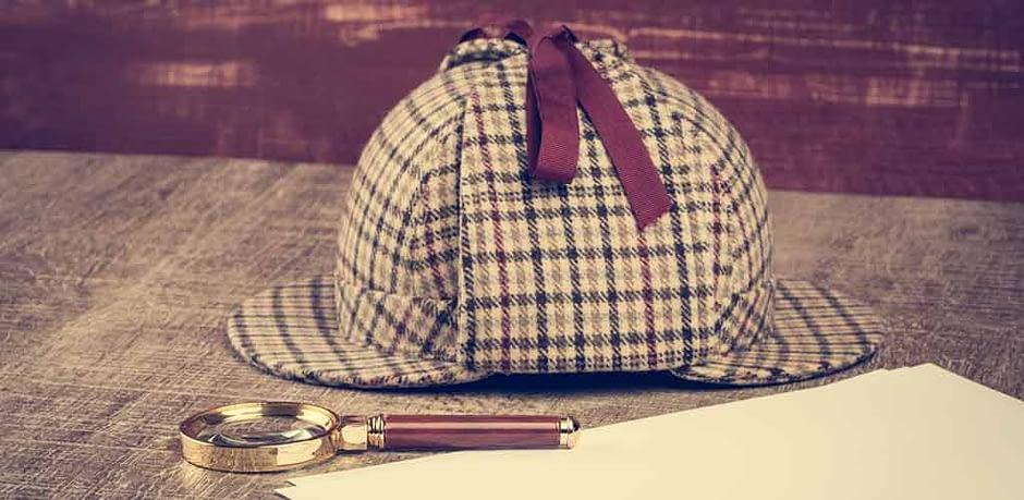 Sherlock Hut und Glas